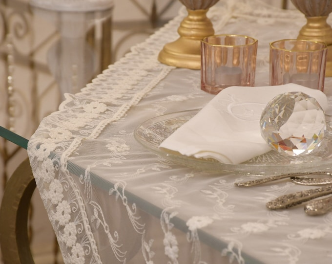Fine table cover in embroidered tulle