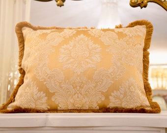 Gold damask cushion and fine trimema