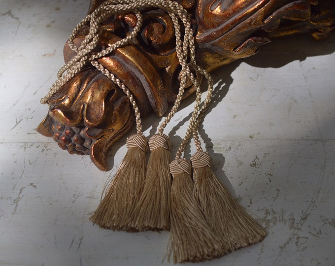 Pair of tassels with cord