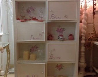 """Bookcase with hand-decorated """"rose"""" doors"""