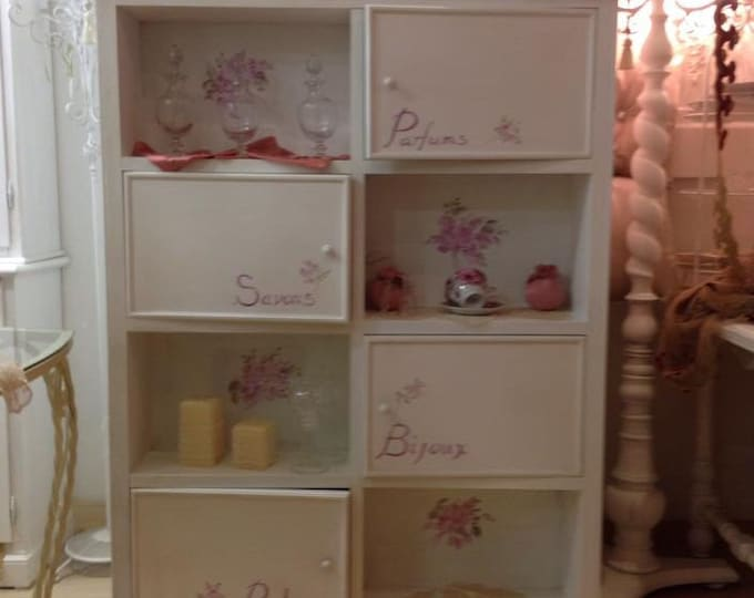 "Bookcase with hand-decorated ""rose"" doors"