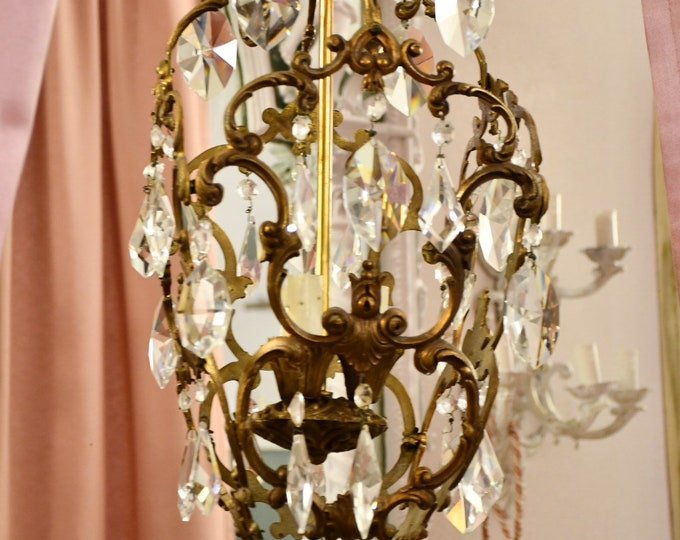 Ancient bronze chandelier of the 20th century three lights