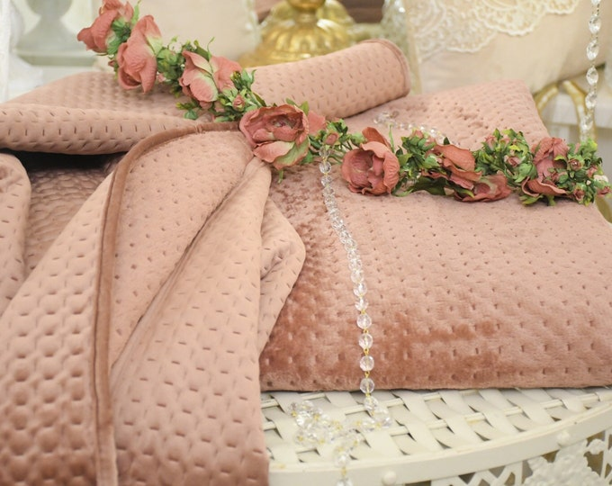 Covered, plaid,quilt in soft antique pink velvet