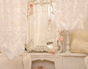 White lace window curtain