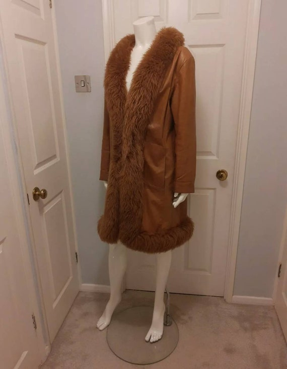 Tan leather coat with shearling trim. Penny Lane b