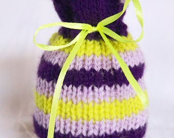 Scented bags knitted with stripes of light purple light green and dark purple