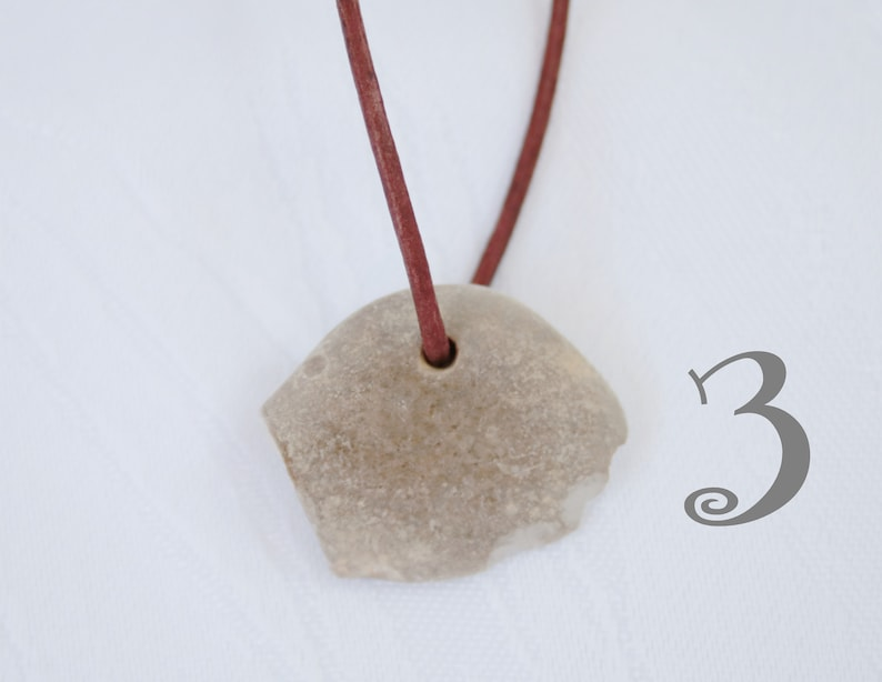 perforated stone pendant Lucky stone unique on fine leather strap