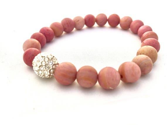 Sweet Rhodochrosite Heart Centered Stone