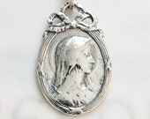 Medal - Blessed Mother Oval Frame with Bow 18x28mm - Sterling Silver