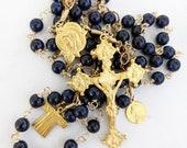 Rosary - Sri Lanka Sapphire Saint Mary Magdalene and Holy Robe of Jesus - 18K Gold Vermeil