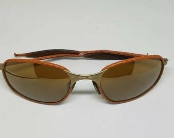 cb280ada2f5d5 Rare Vintage Oakley Wire Leather Sunglasses