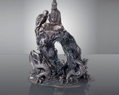 Japanese Meiji bronze sculpture Kannon sits above dragon rising from the sea
