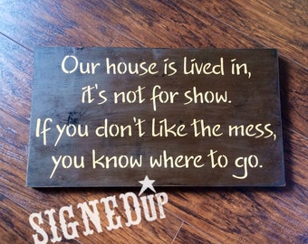 This house is lived in..wood sign