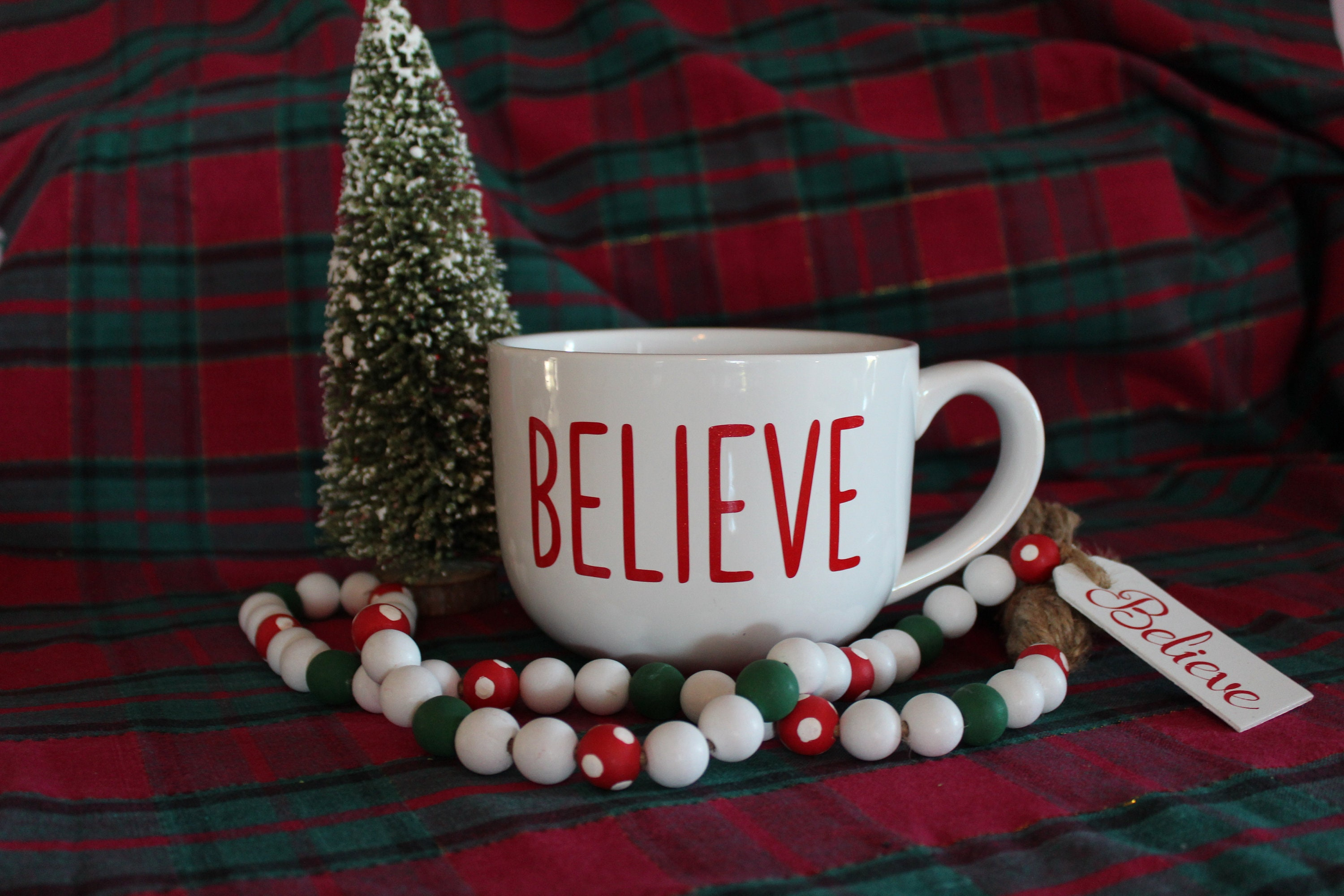 Oversized cocoa mug from GlitterMomz with believe written on it makes a great gift for the woman who's always cold