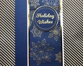 Handmade Christmas card with embossed snowflakes