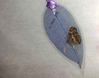 Laminated Butterfly Specimen with dried flowers on the Leaf Oval Shape Bookmark