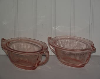 Pink Princess sugar and creamer from the 1930's in good condition.