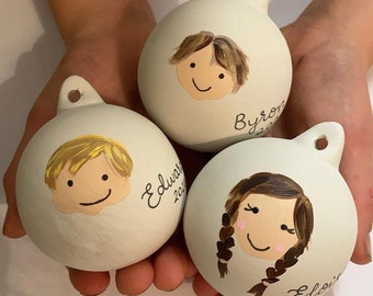 Personalised-Christmas-bauble-face-painting