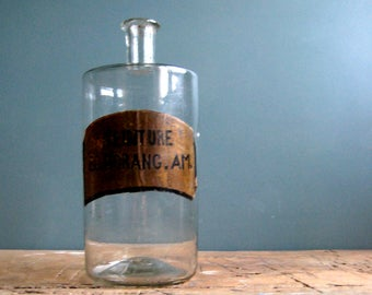 A vintage French pharmacy bottle, large bottle, apothecary bottle, clear glass