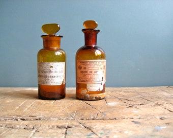 A vintage French amber glass apothecary bottle, medicine bottle, pharmacy bottle, glass stopper, vintage labels