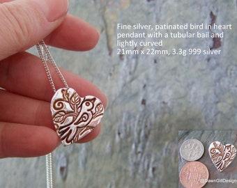 Fine silver textured bird in heart pendant