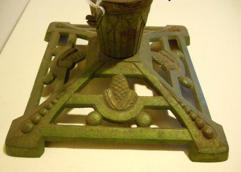 fir cone decoration;  ca 1920 base; art deco Antique cast iron christmas tree stand holder