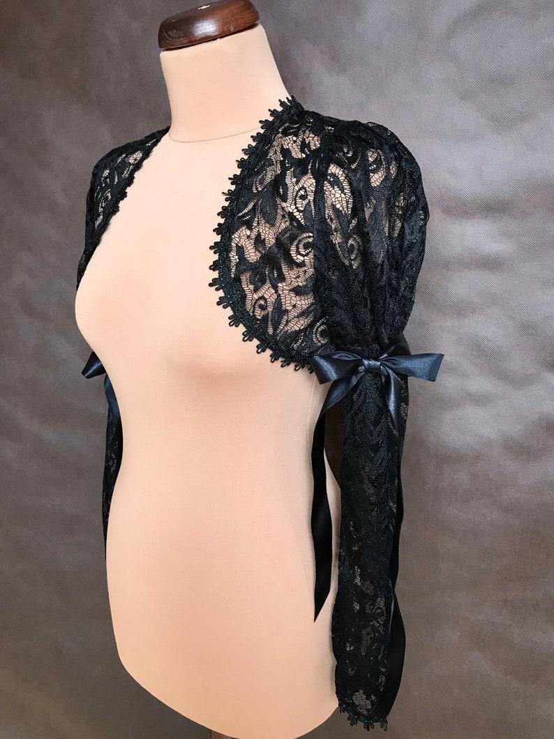 buy online b47e4 7b4ee Burlesque elegante scrollata di spalle BOLERO in pizzo nero con maniche  lunghe grande, prom, feste, halloween