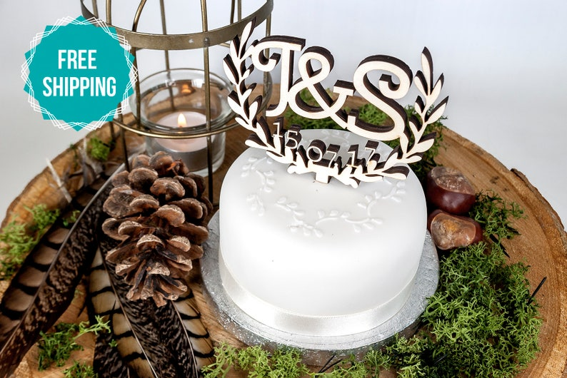 Wooden Wedding Cake Topper Personalised Initials And Date With Wreath Design This Cake Topper Is Available To Order In 3 Sizes