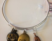 R.I.P. Expandable Bangle Bracelet with Charms,Antique Brass Jack-o-lantern, Antique Gold R.I.P. Tombstone, and Antique Copper Ghost