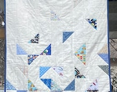 Falling Triangle quilt with glow in the dark space fabric