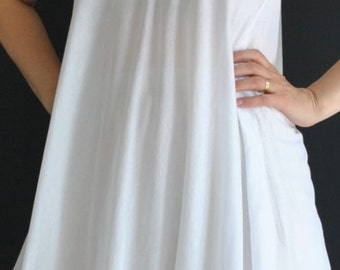 SALE white cotton dress with a modern edge. Wear it as a long blouse  over your favorite jeans, or simply like a mini dress
