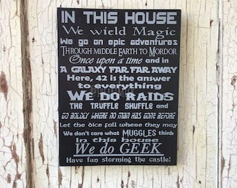 """We Do Geek - In This House 9"""" x 12"""" Painted Wood Sign - Magic Epic Middle Earth Once Upon A Time Galaxy 42 Raids Truffle Shuffle Muggles"""