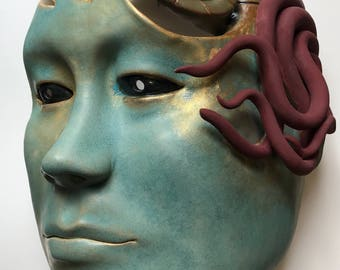 One of a Kind Ceramic Wall Sculpture of Face with Nautilus Shell