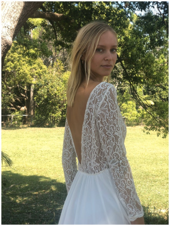 50% deposit Queen Butterfly Paneled Lace long sleeve, low back wedding dress with train.