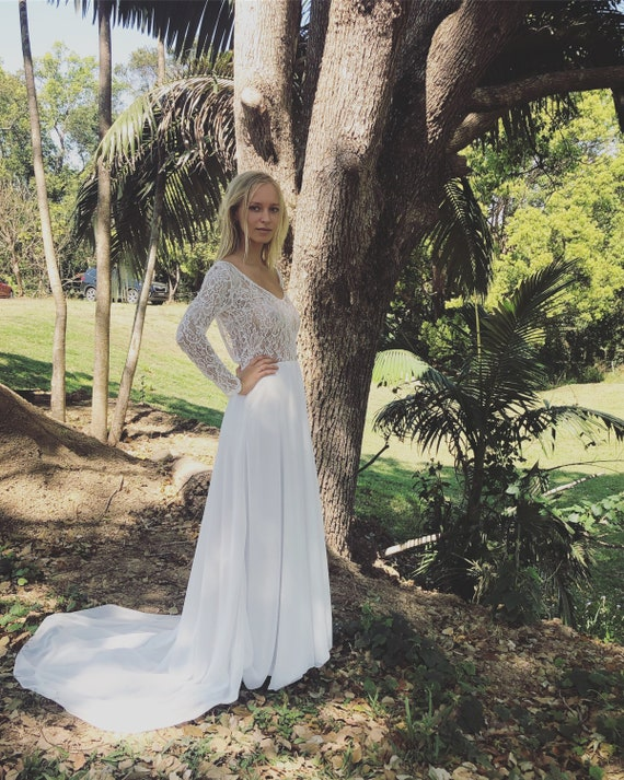 50% deposit Divine Queen Lace long sleeve, low back wedding dress with train.