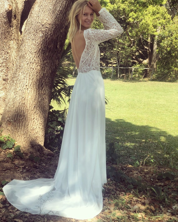 Divine Queen Lace long sleeve, low back wedding dress with train.