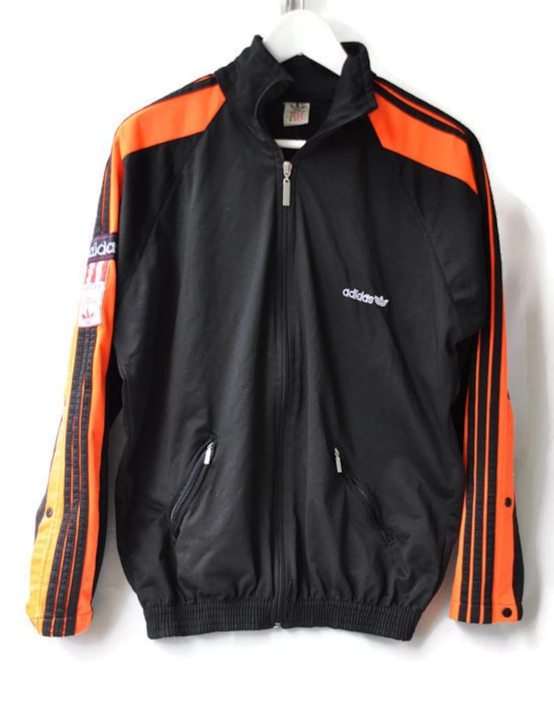 df300e5f6d4a Vintage 90s Adidas Track JAcket Black Orange Slit Side