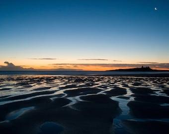 First light on Dunstanburgh Castle and Embleton Bay, Northumberland