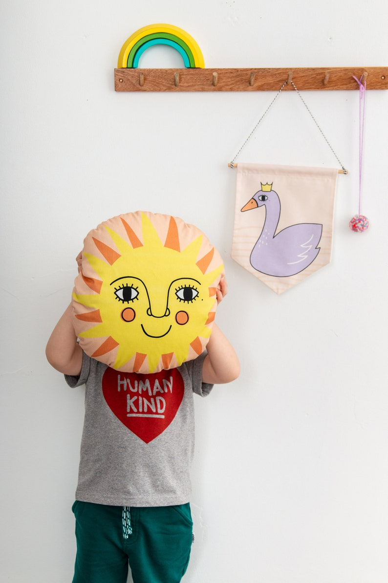 Colourful Folk Sun Nursery Cushion image 0