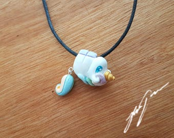 Unicorn necklace pendant with dangly tail, sculpted polymer clay.