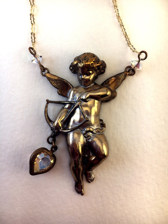 Cupid Necklace with a Mysterious Past