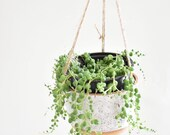Natural Stoneware and white hanging planter with jute strings and copper