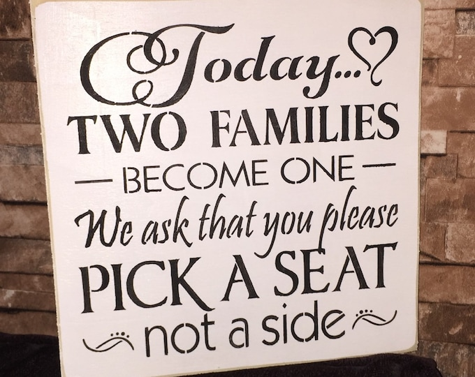Today Two Families Become One Pick A Seat Not A Side White Distressed Wood Sign