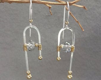 Two tone, wirewrapped, modern crystal earrings in sterling silver and 14 kt gold-filled. Silver and gold crystal earrings.