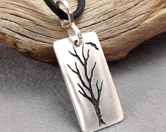 Pure silver tree pendant with sterling bail , hand carved in reclaimed silver. Fine silver tree and bird necklace . Silver tree silhouette