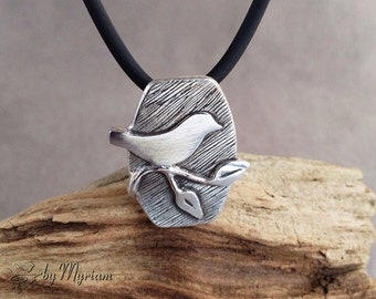 Bird on a branch pendant - 3D small bird necklace in hand carved fine silver . Bird silhouette pendant . Silver bird on a branch necklace