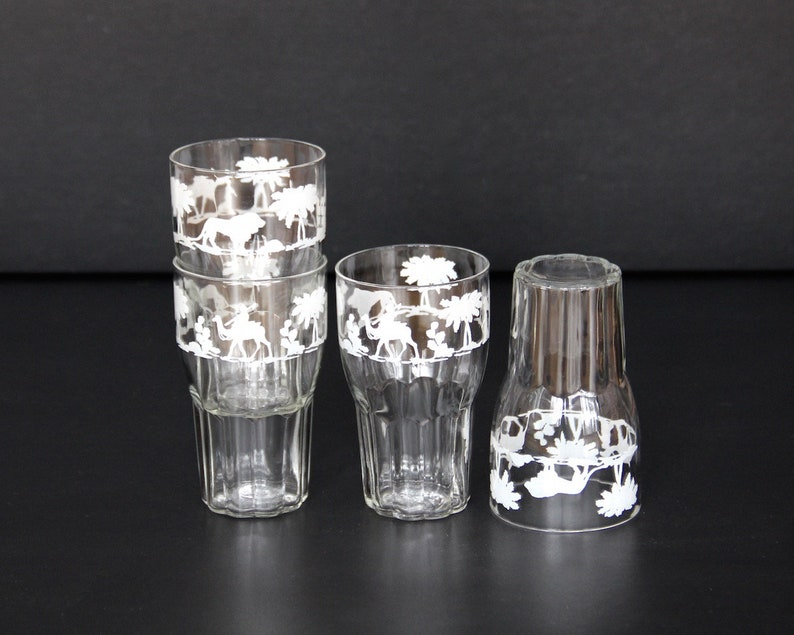 stacking 8 fl oz glasses 4 vintage  juice glasses with lions set of FOUR camels and palm trees