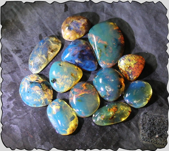 Wholesale lot, biggest 12 Dominican Clear Sky Blue Amber polished Cabochons biggest  35mm  22g