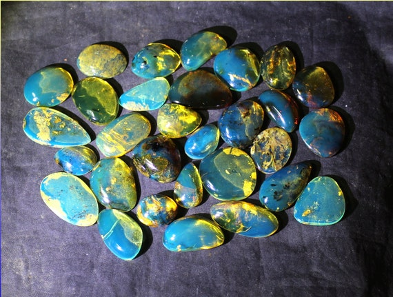 Wholesale liquidation lot, 30 Dominican Clear Blue Amber polished Cabochons biggest  28mm 17grams
