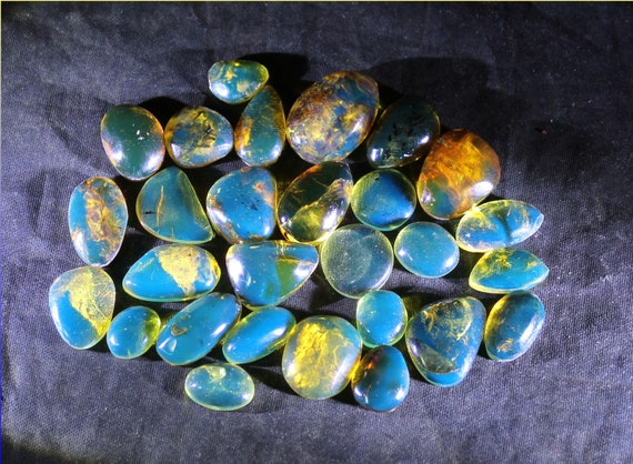 Wholesale liquidation lot, 28 Dominican Clear Blue Green Amber polished Cabochen